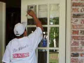 Painter Painting a Door