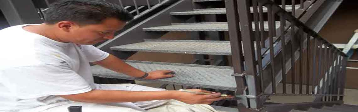 Painting Iron Rails and Steel Decks of Apartment Building